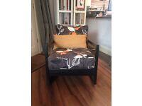 Ikea Lillberg Armchair Rocking chair Black frame with black , white and orange print cushions