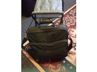 fishing bag with seat,and 2 reels, and various small items inside, hooks, flies ect
