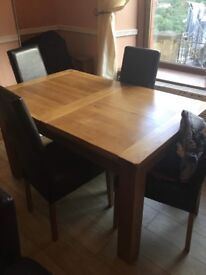 Solid wood table and 4 brown leather chairs