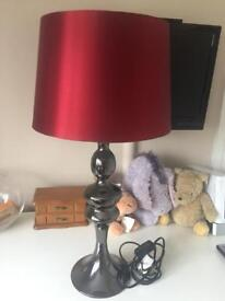 Pewter effect lamp with red lampshade