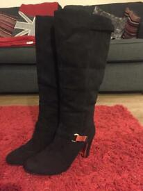 Suede knee length high heeled boots. Size 7.
