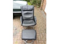 2 Ikea Malung black recliner swivel armchairs and footstools.