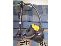 A dyson bag less hoover with all parts included and instructions.