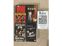 5 rock music VHS tapes.