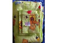 New cot bed sheet set with lightweight quilt