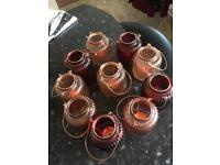 Ten small glass lanterns with bronze candle holder