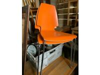 2 x orange retro chairs