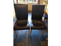 2 faux brown leather chairs