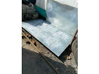 2mtr x 1255 x 0.5mm thick flat galv water marked steel sheet.