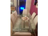 Extendable glass Dining Table and 6 Cream Faux Leather Chairs