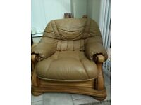 3 piece Italian leather tan suite. Good condition with carved wood finish.