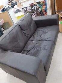 Two seater black faux leather sofa - used but comfy - only £25 - can deliver!