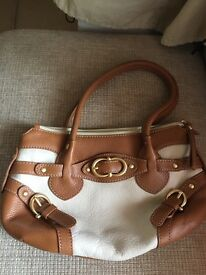 Authentic Coccinelle quality leather cream and tan handbag as new