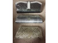 3 brand new clutch bags