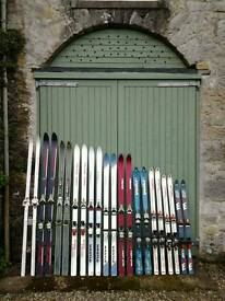 Eleven Pairs of Skis with bindings, both adult and children's sizes.