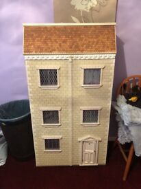4ft dolls house. Complete with 7 rooms, everything inside is included.
