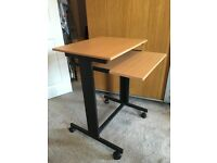 Computer desk with sliding shelf