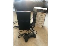 Sony PlayStation 2 PS2 console with 2 memory cards, controller and 22 games