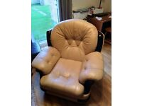A pair of single seat sofas, real leather, firm and comfortable in decent condition