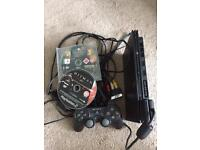 PlayStation 2 slim console with games