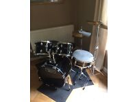 Black Mapex drum kit and stool