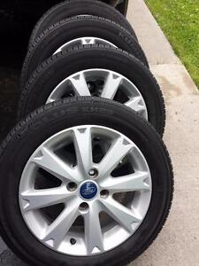 FORD FIESTA 2013 FACTORY OEM 15 INCH WHEELS WITH HIGH PERFORMANCE KUMHO 185 / 60 / 15 ALL SEASON TIRES.