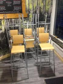 9 wooden chairs.