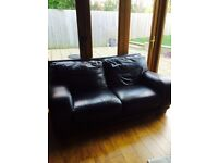 2 and 3 seater brown leather sofa and a 2 seater and a chair in purple fabric