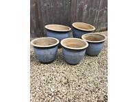 Set of light blue flowerpots