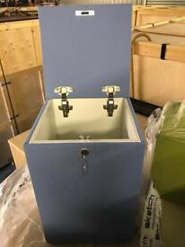 Lockable storage box with cushion