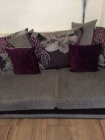 Light grey comfy sofa with purple scatter cushions less than 2 year old good condition
