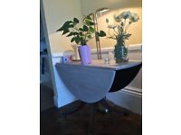 Beautiful round adjustable dining or salon table