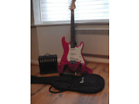 Stunning CRUISER CRAFTER Stratocaster Guitar In Red, and amp