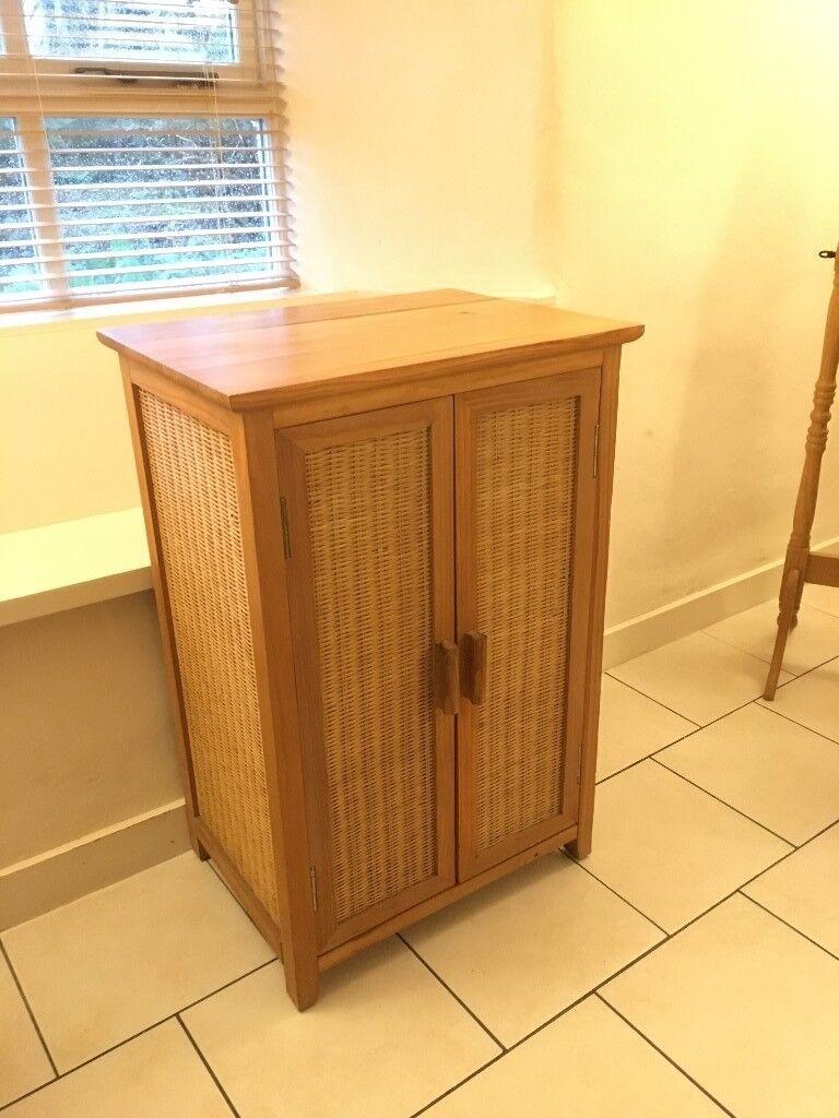 Wicker crockery cupboard