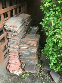 Old & new red clay roof tiles