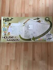 New in box Colour in cardboard play house
