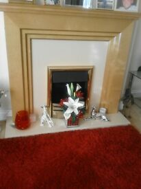 Teak fire surround with electric heater