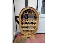 Oval free standing wooden wine rack