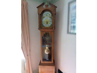 Grand Father clock with an Oak case, in full working order with chimes