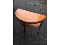 Half moon table with shelf below Size L 30in D 15in H 28.5in