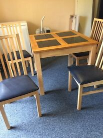 Small 3 foot square light oak table and 4 chairs