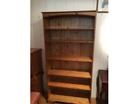 Pine bookcase with 5 shelves adjustable , pine back . Size L 38in D 12in H 74in Free local delivery.