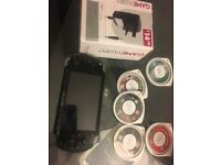 PSP console and charger (unopened brand new charger)