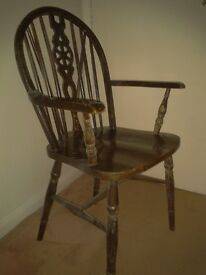 Oak wheelback carver chair, old and used daily