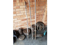 SELECTION OF WEIGHT PLATES AND BARS