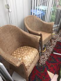 Two Lloyd loom style chairs