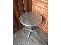Metal silver table for indoor or outdoor use