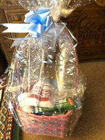 Basket full of goodies for newborn baby boy ideal for baby shower
