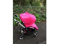Bugaboo bee pushchair with hot pink accessories