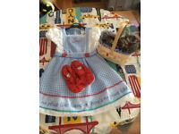 Girls Wizard of Oz dress, shoes and Toto dog in a basket